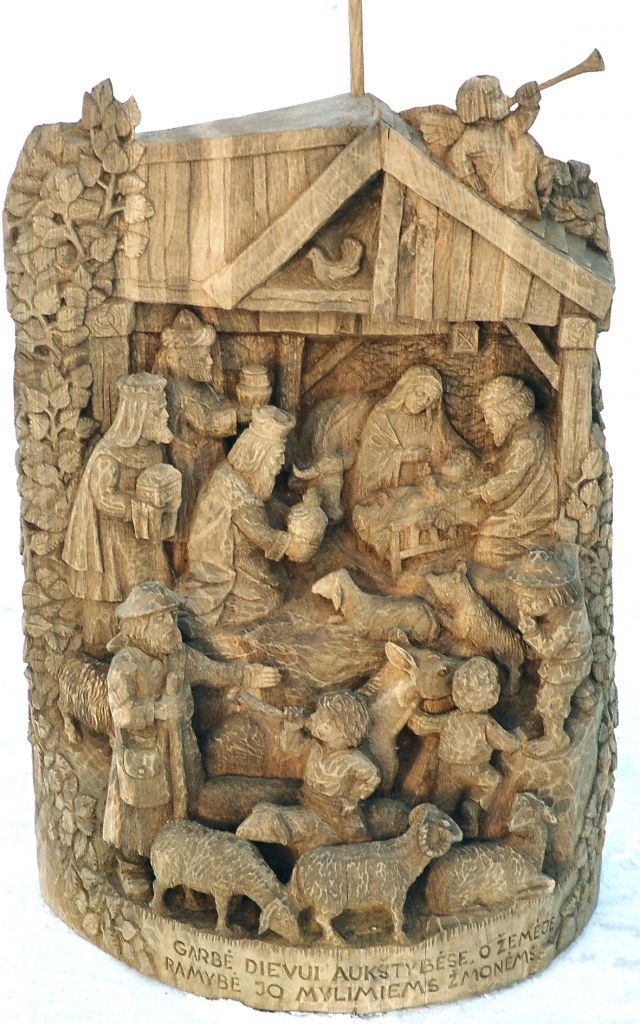 Traditional Lithuanian wooden sculpture - Nativity scene. The bottom inscription says: Gloria in Excelsis Deo and Peace on Earth to his beloved people.