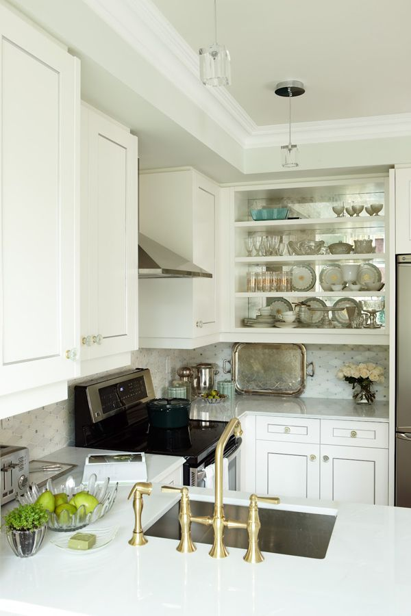 Sarah Richardson:  Sarah 101.  I love the marble mosaic backsplash with this countertop.  The antique mirror insets on the cabinets is a great way to visually add more 'space' to this tiny kitchen.