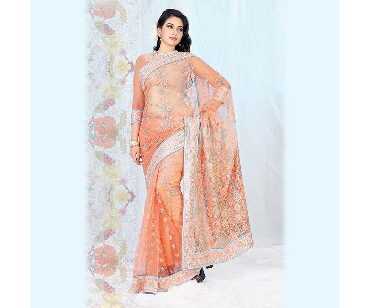 The Orange designer saree with orange and silver Flower design embroidery.