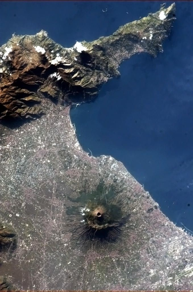 Mt Vesuvius exploded w/the energy of 1000 nuclear bombs in 79 AD: about 16,000 people died as rock & ash poured out at a rate of more than 1M tons per sec. It was so devastating that it has become an icon of the terror of an active volcano. NASA Photo