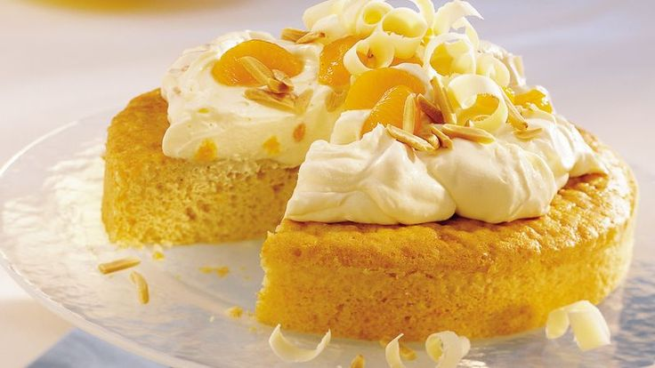 A fluffy cloud of pudding, whipped topping and oranges makes a melt-in-your-mouth topper for a homemade orange cake.