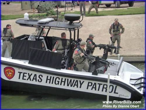 """""""Texas highway patrol"""" police float on one of their 34-foot, $0.5 Million armored gunboats, mounted with six (6) M-240 machine guns. Law Enforcement Today www.lawenforcementtoday.com"""