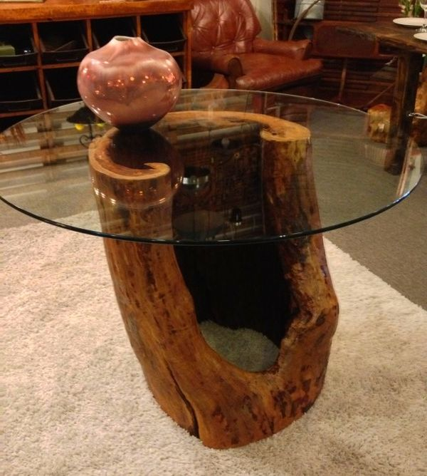 """Reclaimed wood dining table made from natural hollow tree trunk and 42"""" glass top.  See it at Urban Mining Homewares www.urbanmininghomewares.com"""