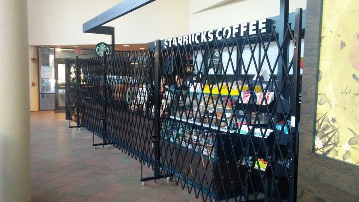 Starbucks kiosk secured with powder coated black portable security gates