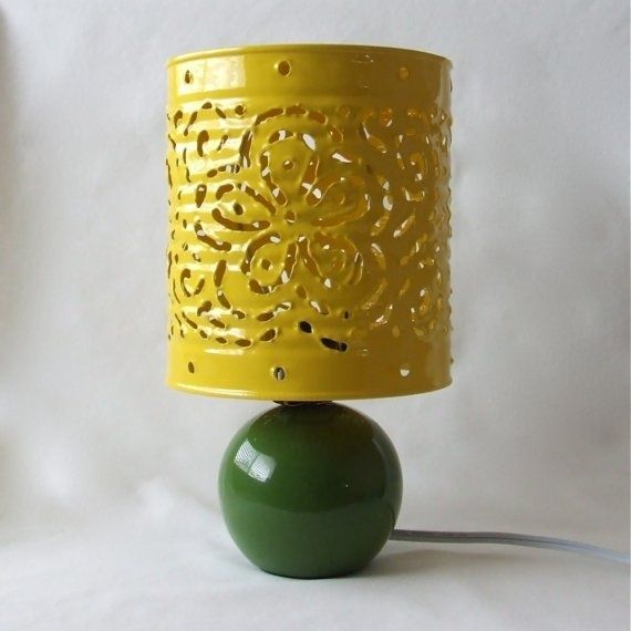 Paint a tin can and cut out the design of your choice to make this adorable lampshade.