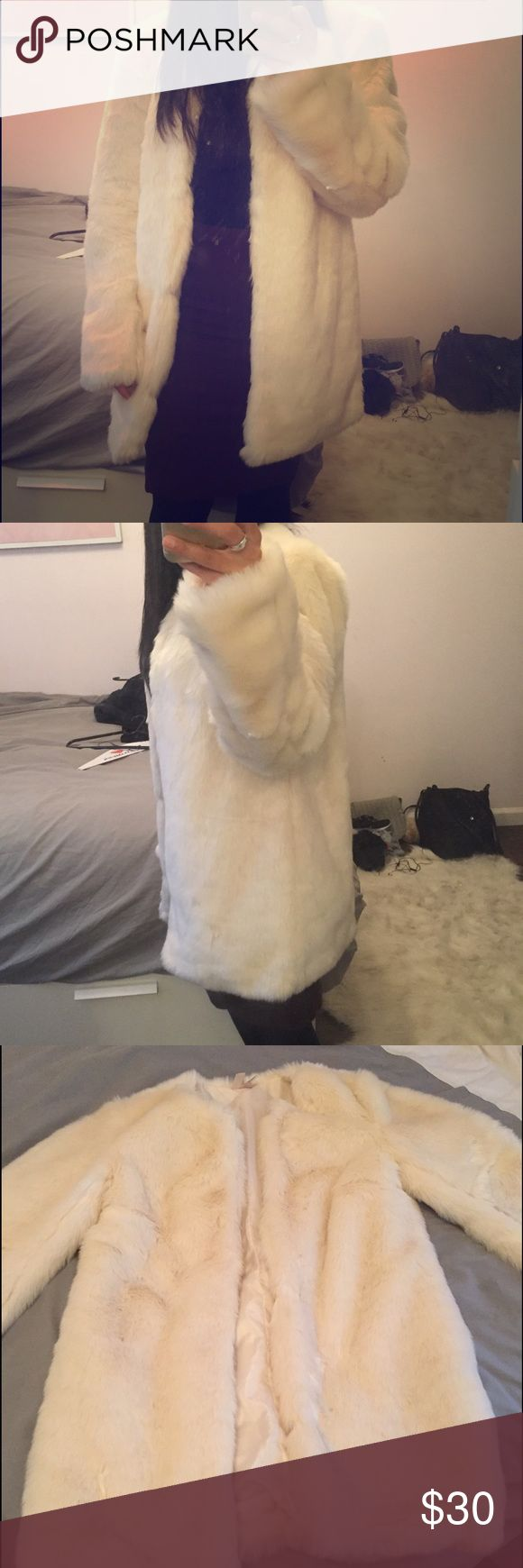 White faux fur coat Great white faux fur coat. Sits past waist and worn only once! No stains Jackets & Coats