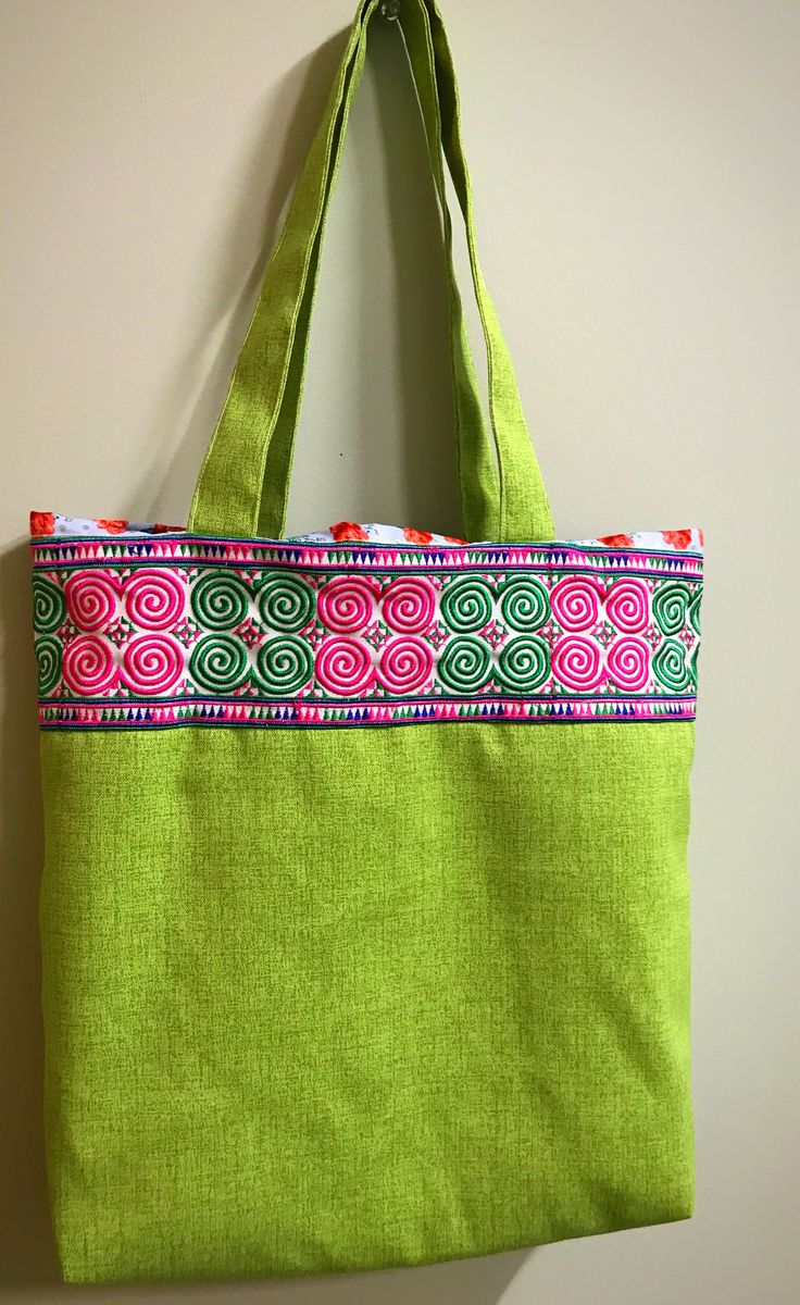 """A beautiful hmong tote bag make by hand.  Hmong embroidered design in snail art pattern flowers  Size 16""""*12"""" Color green, materials canvas, wool, thread sew pattern art  Designer: Chue Her  Available for sale at Etsy https://www.etsy.com/shop/OpenSesameCraft"""