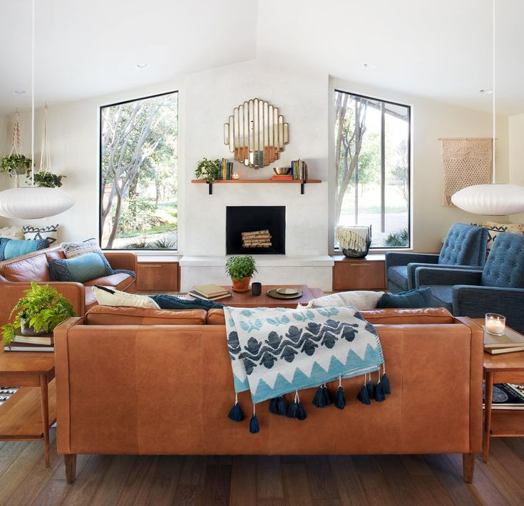 I like how they paired the blue chairs with brown/tan couches. Keep in mind for blue couch. Episode 06 - The Safe Gamble House - Magnolia Market