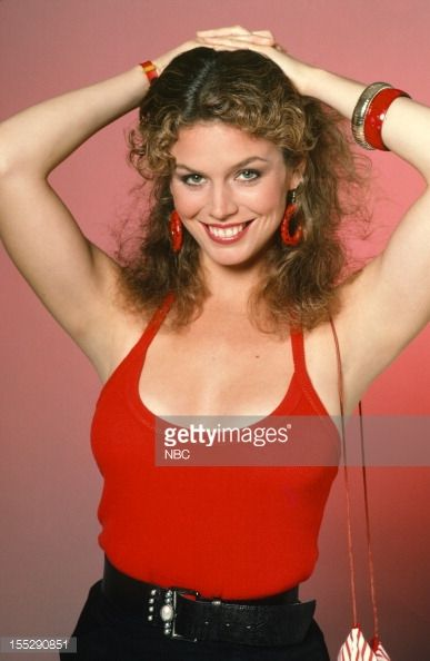 Megan Gallagher as Officer Tina Russo on Hill Street Blues