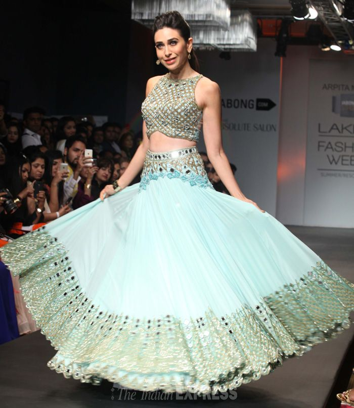 Karisma Kapoor stuns in a pale #blue gown creation from Arpita Mehta during the Lakme Fashion Week Summer/Resort 2014, in Mumbai. (Photo: IANS) #bollywood #paleblue #KarishaKapoor #ArpitaMehta #peacock