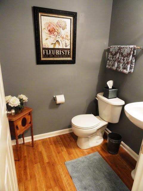 love the grey walls and the wood floors bathroom
