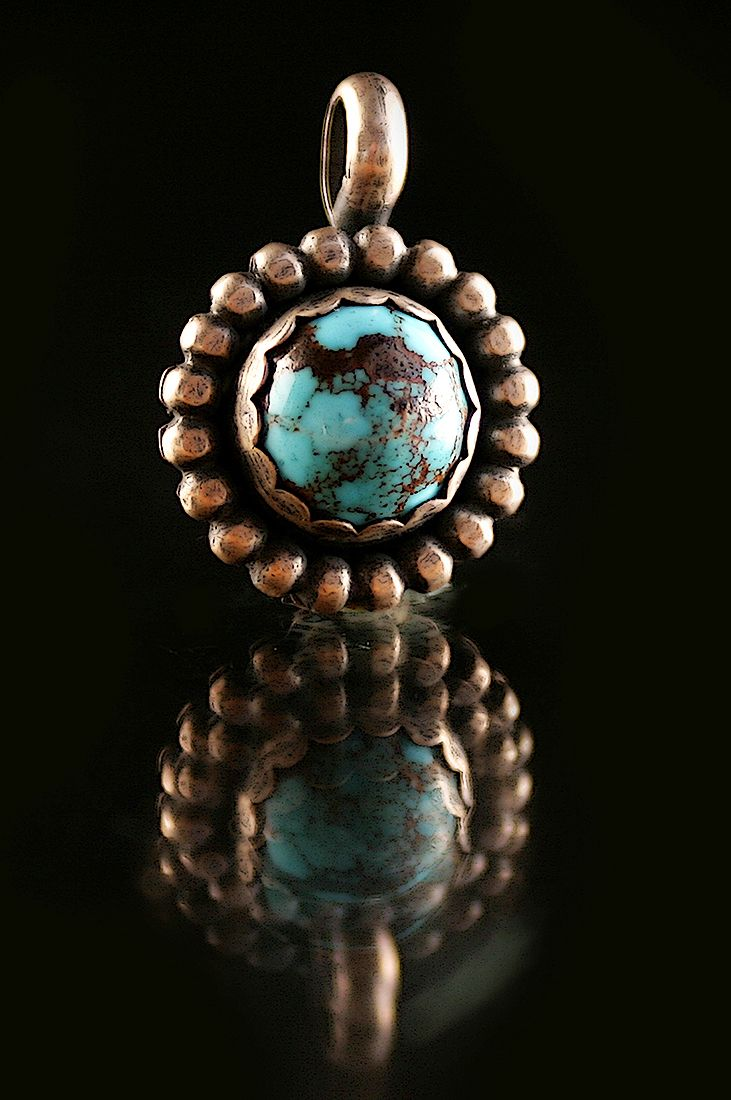 Bisbee, Arizona Turquoise hand crafted sterling silver pendant by Lisa Marie Morrison of Sirocco Design, Tucson, AZ and Los Molles, Chile. Photography by Pablo Rivera for La Ruta Sin Fin.