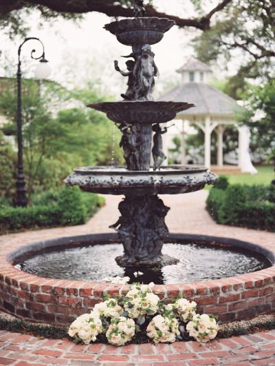 Uber romantic water fountain: http://www.stylemepretty.com/louisiana-weddings/lafayette-la/2014/09/02/romantic-elegant-louisiana-wedding-at-the-victorian-plantation/ | Photography: Sarah Beth - http://sbethphoto.com/sarah-beth/