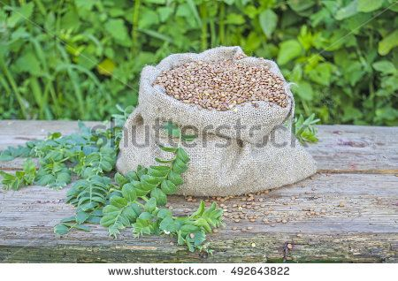 Burlap bag with lentils on a table of old wood