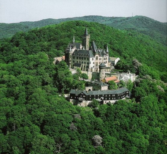 Wernigerode Castle in Germany is a Romanesque castle dating from the 12th century. The grand turreted stone and half-timber castle boasts magnificent views over the medieval town of Wernigerode.