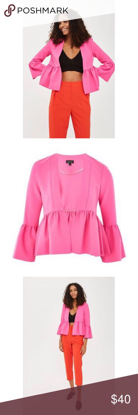 TOPSHOP Hot Pink Crop Frill Ruffle Cropped Jacket New Without Tags! TOPSHOP Hot Pink Crop Frill Bell Sleeve Cropped Jacket  US Size 0 UK Size 4 Jazz up your outerwear with our directional pink frill jacket.  This structured style boasts an open front and extravagant peplum frills to the sleeve and hem.  Piece together a party look by introducing a crop top and colour-pop crops to the mix.  Material: 93% Polyester, 7% Elastane. Dry clean only.  Color: pink Sold Out In All Stores And Online…