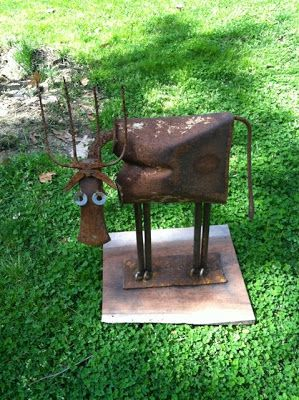 Cow made from old garden tools and metal!