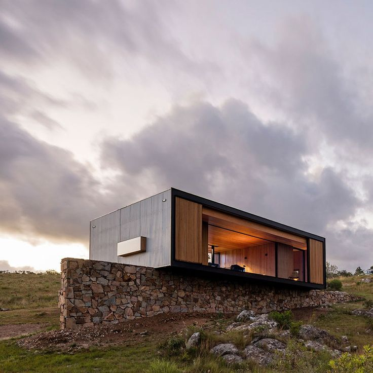 Vying to be the most beautiful house ever built in a factory, this compact property was prefabricated near the Uruguayan capital, before being transported 200 kilometres to a picturesque olive grove surrounded by rolling hills.