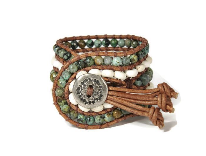 A bohemian trend bracelet !!! Semi precious stones of turquoise & howlite are framed by brown leather woven together with brown cotton cord. This eye catching design also features a silver metal, oxidized closure.This bohemian style bracelet upgrades your casual or evening look.