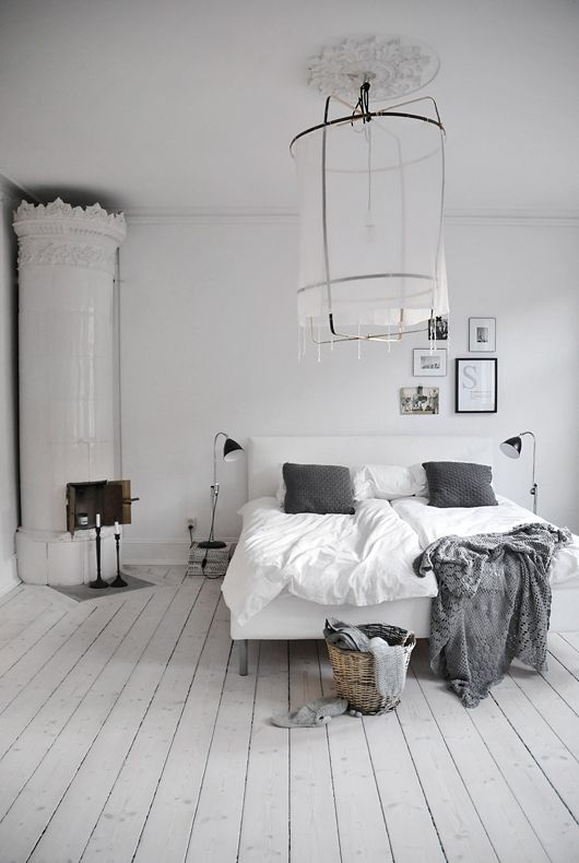 White and grey harmonious bedroom.