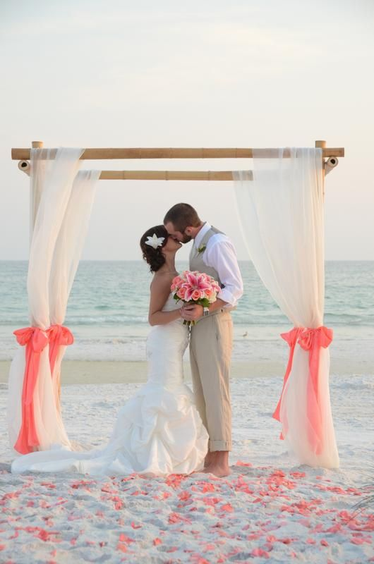 Natural Bamboo Beach Wedding Arbor Draped Curtain Style With Coral Sashes And Rose Petals In Grayton