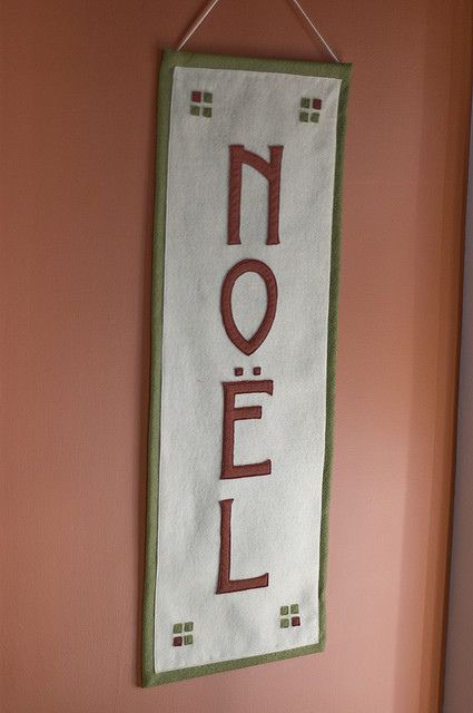 Craftsman style noel banner made with ivory, russet and sage green felt applique that I made for my sister -- Christmas decorating -- wall color is Benjamin Moore Audubon Russet