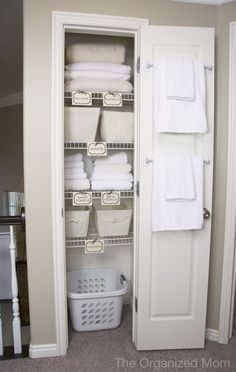 Guest room closet - like the idea of a   laundry basket in there for guests to put their dirty linens in and towel bars   on the inside of the door