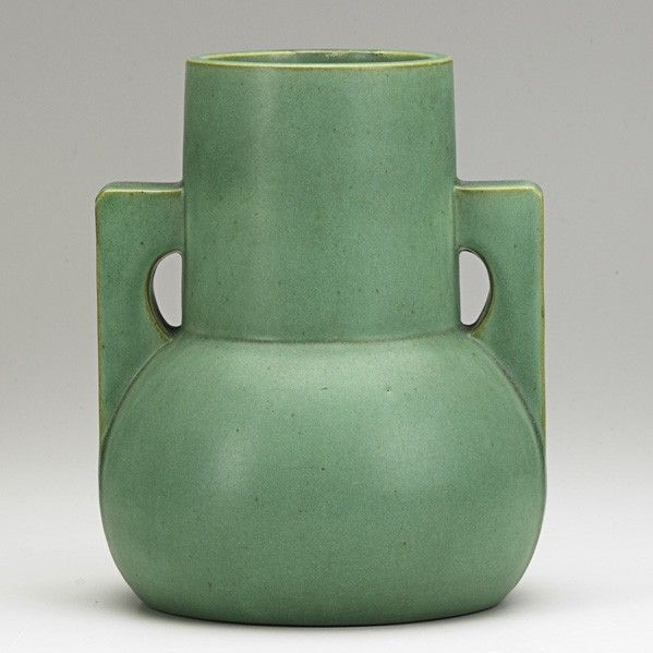 Teco Vase, ca. 1910. Many Teco pottery shapes were inspired by Chicago architecture in the early 20th century. The geometric form of this vase resembles shapes found in architectural design.