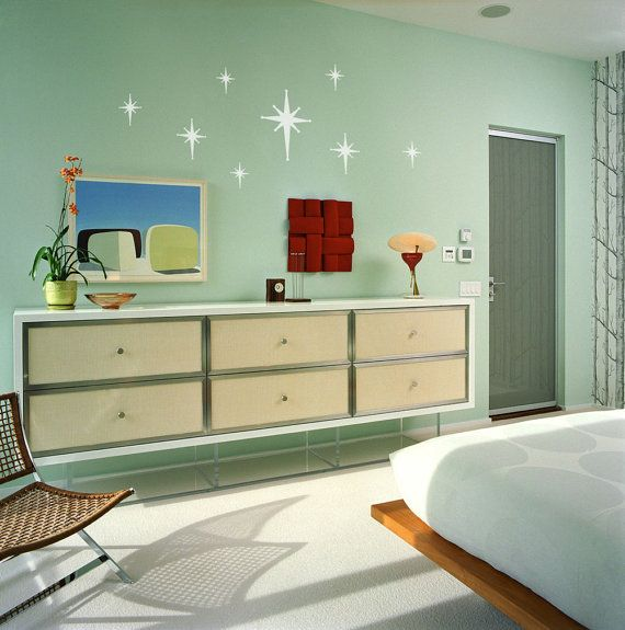 A set of 8 white retro star burst wall decals in mid century modern 1950s and 1960s atomic era style. These durable re-positional woven fabric