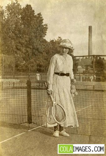 Woman Playing Tennis - Vintage Stock Photo