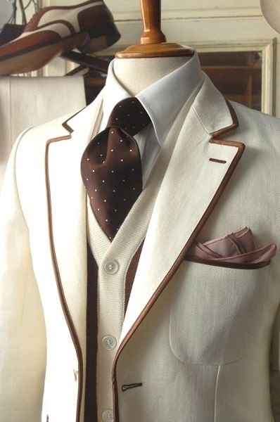 Sharp Dressed Man! Cream suit with coffee brown trim...