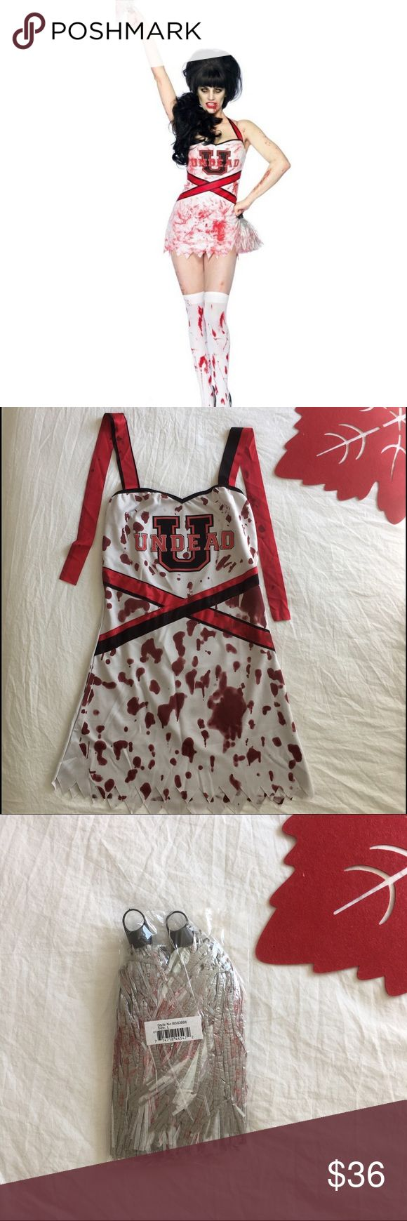 """🎃 ADULT ZOMBIE CHEER SQUAD MOVIE COSTUME Zombie Cheer Squad Movie Costume includes a red, white, and black dress with distressed hem, blood spatters, and """"Undead U"""" design, plus a set of bloodied pom poms. Please note, makeup, wig, stockings and shoes are not included. Adult size Medium. Material: Polyester. Care Instructions: Spot Clean Other"""