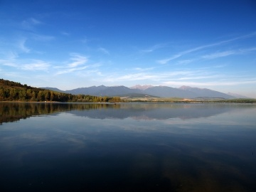 Evening reflection of mountains in Liptovska Mara lake, Slovakia.