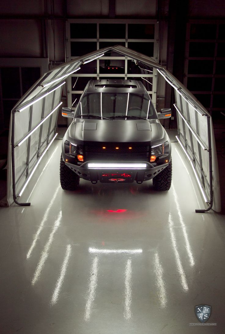 Ford SVT Raptor in the Light Tunnel at NorthWest Auto Salon after getting Matte and Satin Wrap and Custom Graphics installed
