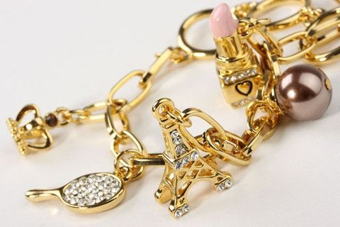 """Soir Du Paris Bracelet Gold: An """"Evening in Paris"""" inspired charm bracelet with Eiffel tower, lipstick, pearl and crown charms set with Swarovski crystals. A playful bracelet for a lovely relaxed chic. 18 carat gold electroplated over brass. Adjustable length to 7 inches / 18 cm. Can be enhanced with Handbag, Stiletto & Sunnies charms, Heart, Star & Padlock charms or Jeans, Guitar & Bikini charms. $149.90"""