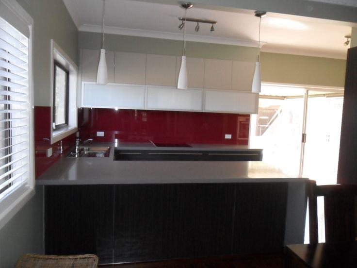 Polyurethane kitchen, stone top and glass splash back - a multi-tone kitchen and hanging lights