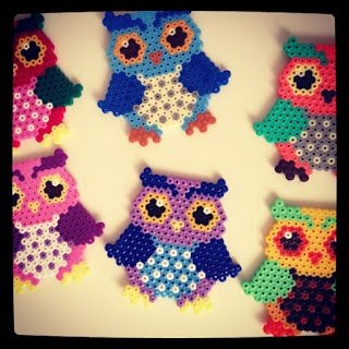 Owl coasters made from perler beads.