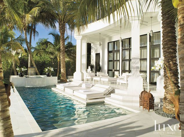 White Pool Deck Chairs: White Alabaster Stone Covers This Patio, Extending Into