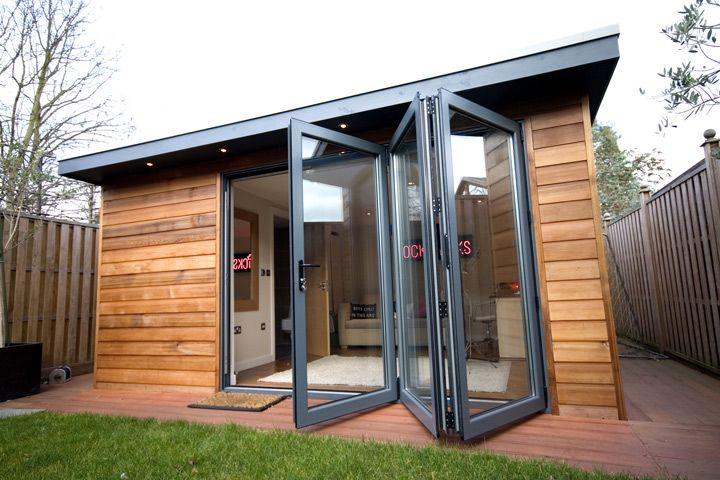 Garden Shed with large glass doors that open.....very nice! All the light my @Bonnie S. Plants will require! :-)