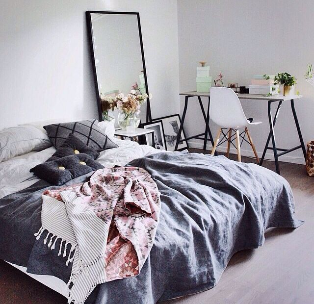 Calming colours: blush pink & blue textiles in this minimal bedroom featruing Vitra Eames DSW Plastic Char