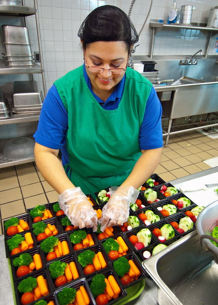 https://flic.kr/p/ayDUmM | 20111019-FNS-RBN-1703 |   Rosalba Gomez, Arlington Food Services prepares fresh vegetable cups for the National School Lunch Program in the kitchen at Washington-Lee High School in Arlington, Virginia, on Wednesday, October 19, 2011. The National School Lunch Program is a federally assisted meal program administered by the United States Department of Agriculture, Food and Nutrition Service operating in public, nonprofit private schools and residential child care…