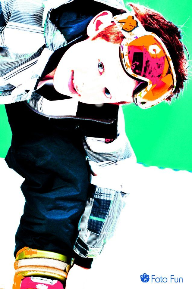 Cool boy in snowboarding set