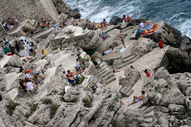 There's the cliffside Buza Bar just beyond the city walls of Dubrovnik, Croatia: | What's The Coolest Bar You've Ever Been To?