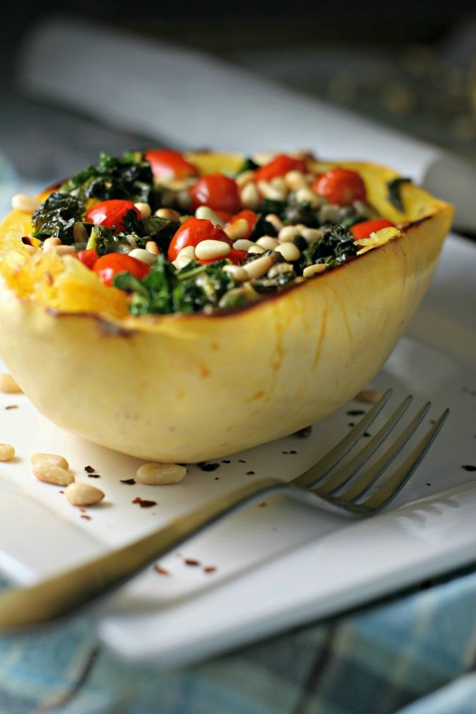 Arrabbiata Spaghetti Squash Bowls, spicy tomato sauce with kale, capers and pine nuts on a bed of spaghetti squash for a low-carb dinner!