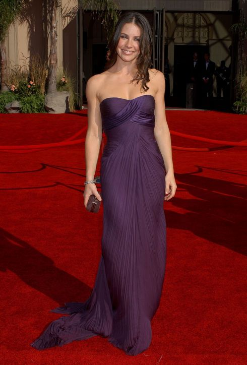 Best Emmy Awards Dress: Evangeline Lilly, 2006 All it took was one glance at Evangeline Lilly's regal Versace dress and we completely fell in love. The pleated details and fitted bodice showed off Evangeline's killer figure for maximum hotness.