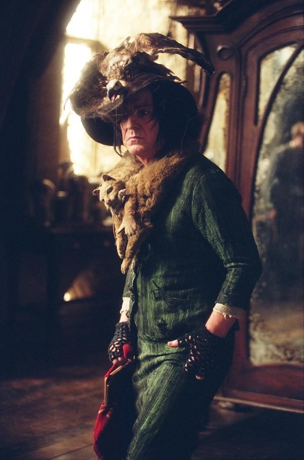 Snape. (Wonder how much grief he got from the younger actors for this part of his wardrobe?) :)