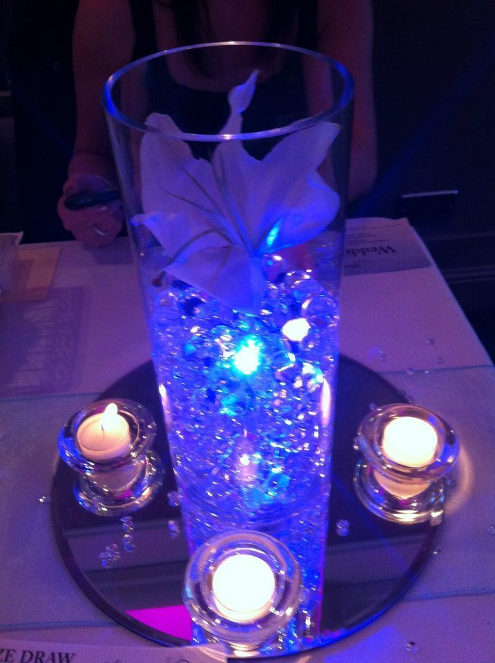 "LED ""submersible"" lights can really add pizazz to DIY table centerpieces! Covering 1 little long-lasting light with beads helps the color reflect beautifully: http://www.flashingblinkylights.com/ledsubmersiblecraftlights-c-114_462.html"