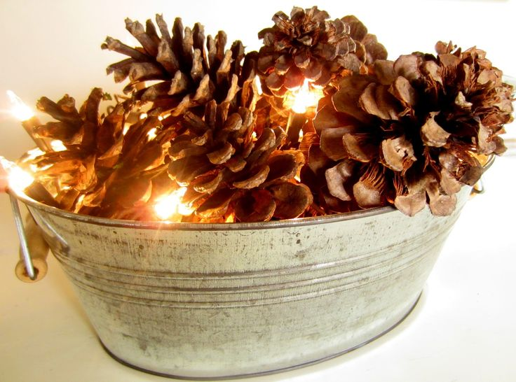 Down to Earth Style: Aging Metal - love the idea of using brown lights and pine cones.  Cute and simple.