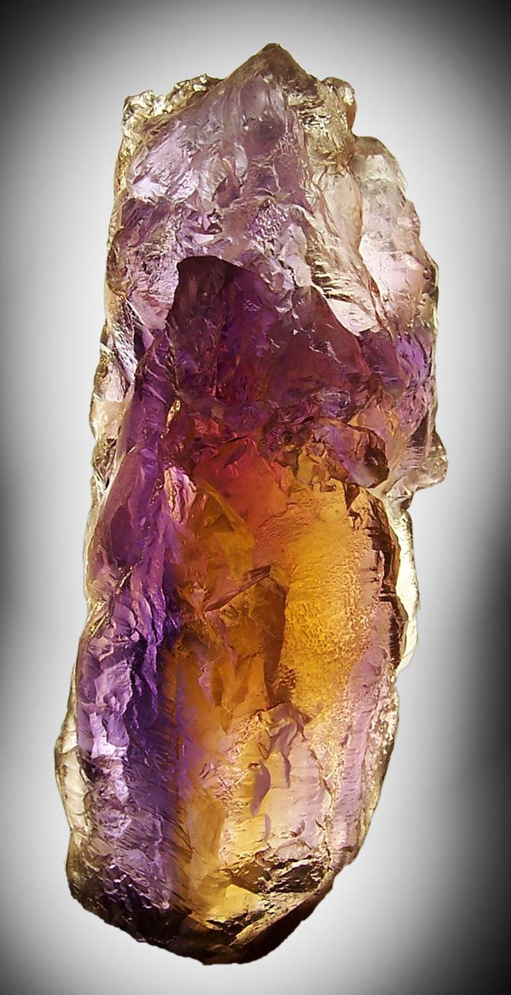 Bolivian Ametrine Crystal. In the Amethyst family. Stones of spirituality and contentment, it bestows stability, strength, inner peace