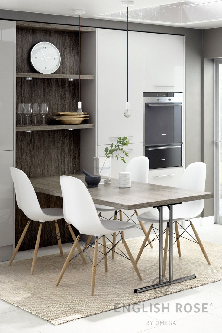 Modern gloss grey kitchen.  This design features open shelving with a bespoke integrated table, great for casual dining.